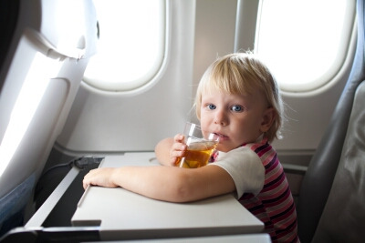 Photo of a boy on the plane